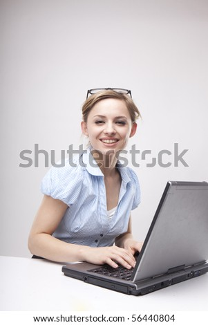 Young business woman on a laptop wearing casual - stock photo
