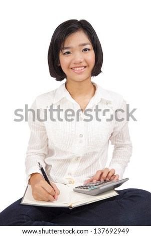 Young business woman on a white background.