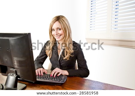 young business woman on her computer isolated on white - stock photo