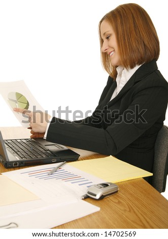 young business woman on sitting down, working on her table - stock photo