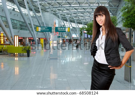 Young business woman on the background of a modern airport - stock photo