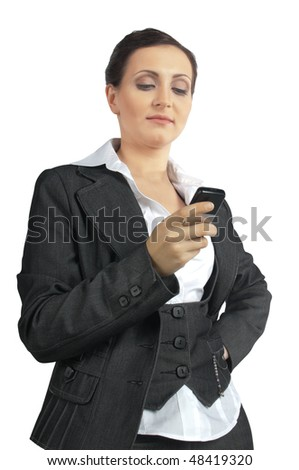 Young business woman on the phone dials the number on a white background - stock photo