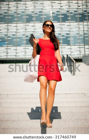 Young business woman outdoors on a summer day