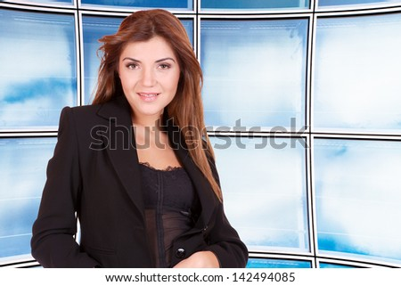 Young business woman over office windows