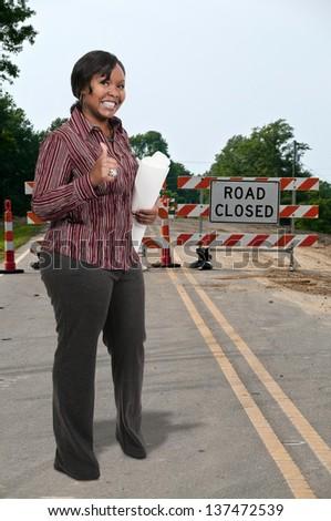 Young business woman performing her job duties - stock photo