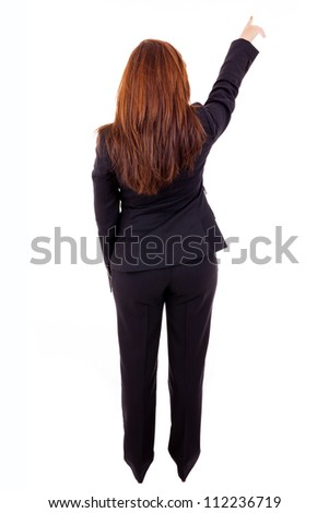 Young business woman pointing at something, isolated on white background