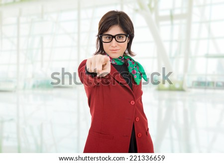 young business woman pointing at the office - stock photo