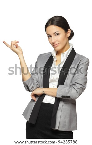 Young business woman pointing at white copy space, isolated on white background - stock photo