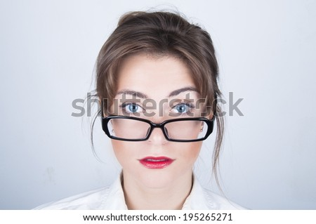 Young business woman portrait in  black glasses - stock photo