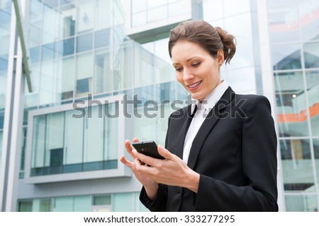 Young business woman portrait near office building