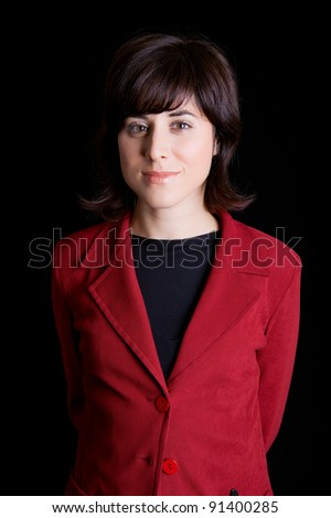 young business woman portrait on black background - stock photo