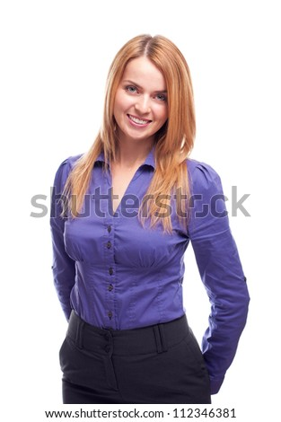 Young business woman posing in studio against white background and smiling