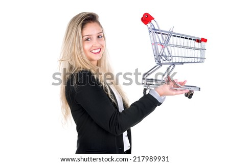 Young business woman posing with shopping cart, isolated in white