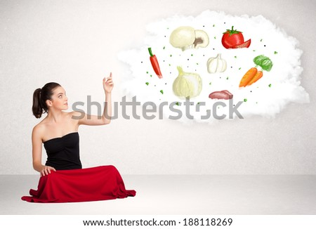 Young business woman presenting cloud with nutritional vegetables food - stock photo