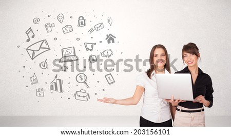 Young business woman presenting hand drawn media icon cloud - stock photo