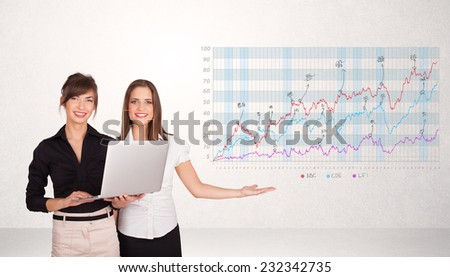 Young business woman presenting stock market diagram analysis - stock photo