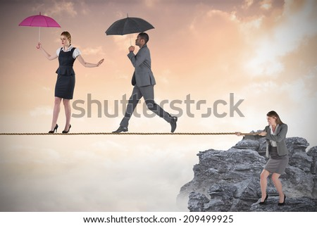 Young business woman pulling a tightrope for business people against white background with vignette - stock photo