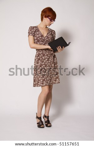 Young Business Woman Reading Notebook - stock photo