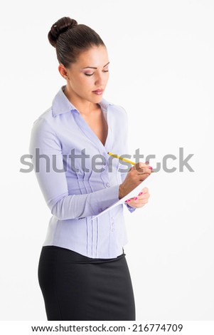 Young business woman reading on white background