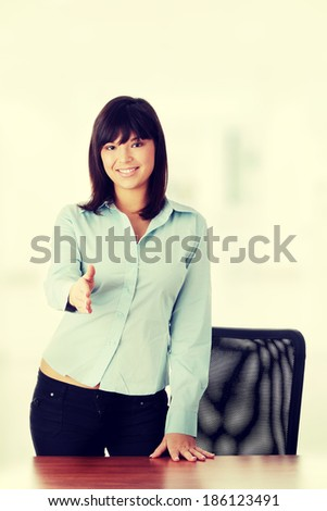 Young business woman redy for handshake - stock photo