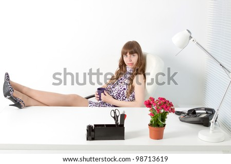 young  business woman rests in a comfortable modern office - stock photo