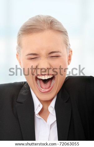 Young business woman shouting - stock photo