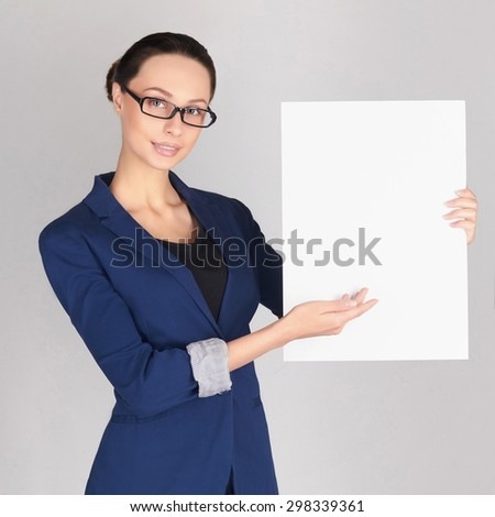 young business woman showing blank signboard, isolated on white background.girl manager in glasses - stock photo