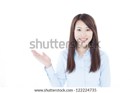 young business woman showing copy space, isolated on white background