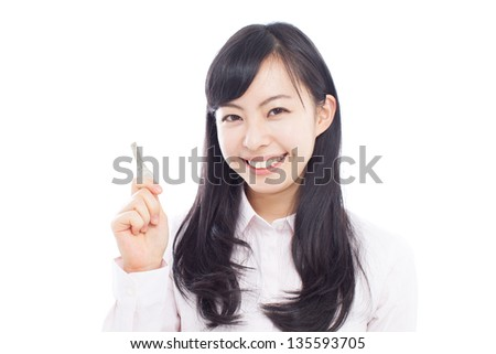 Young  business woman showing key isolated on white background - stock photo