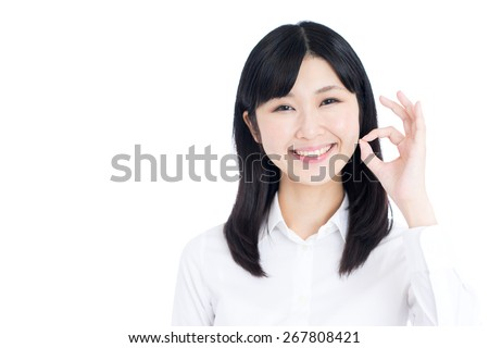 young business woman showing OK gesture isolated on white background - stock photo