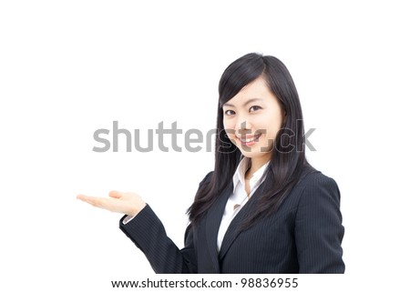 young business woman showing something, isolated on white background - stock photo