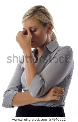Young business woman showing stress isolated over white background - stock photo