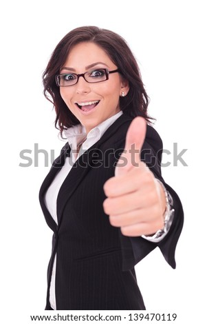 young business woman showing the thumb up gesture with a big smile on her face while looking at the camera. on white background - stock photo