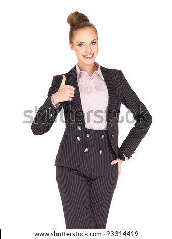 Young business woman showing thumb up gesture - stock photo