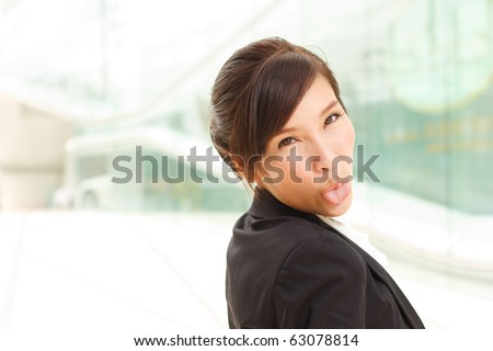 Young business woman showing tongue!