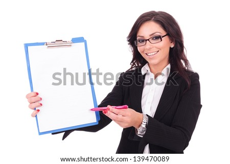 young business woman showing you with her pen where to sign on the clipboard with a smile on her face. on white background - stock photo