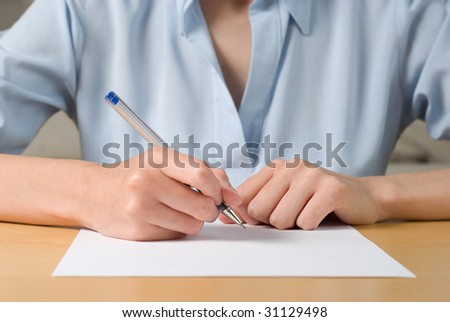 Young business woman signing a documen - stock photo