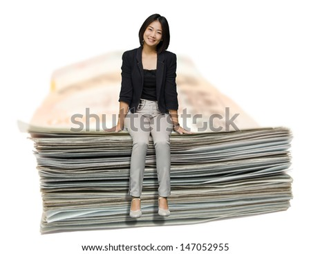 Young business woman sit on a sum of banknote with isolated on white : Easy money saving plan to enjoy happy early retirement life, Asia Thailand - stock photo