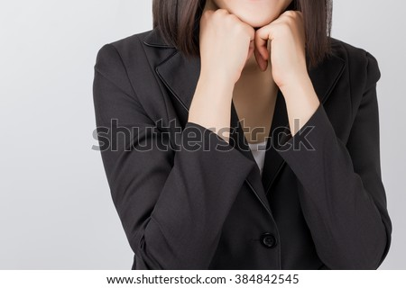 Young business woman sitting and rest the chin on her hands. - stock photo