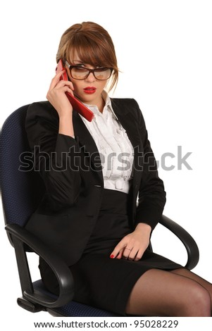 Young business woman sitting in office chair with cellphone - stock photo