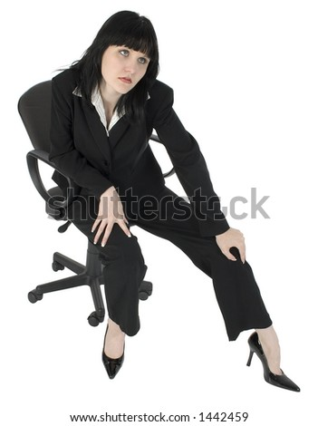 Young business woman sitting in office chair with tired or stressed expression.