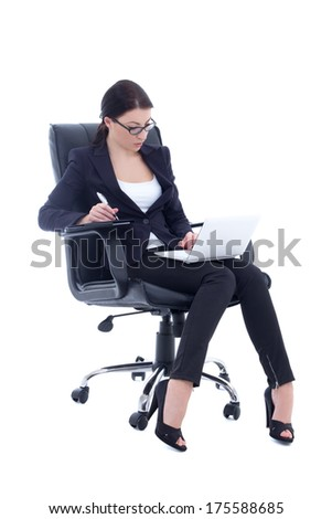 young business woman sitting on chair and working with laptop isolated on white background