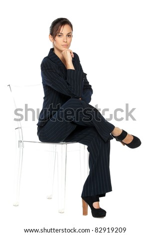 Young business woman sitting on the transparent chair, isolated on white background
