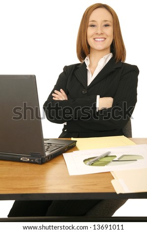young business woman smile and sit behind her desk with laptop and files - stock photo