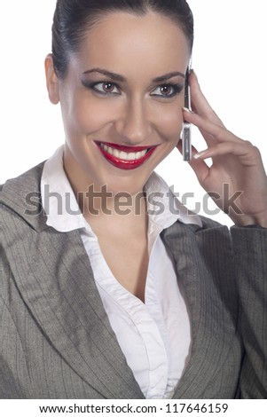 Young business woman smiles and talking with mobile phone - stock photo