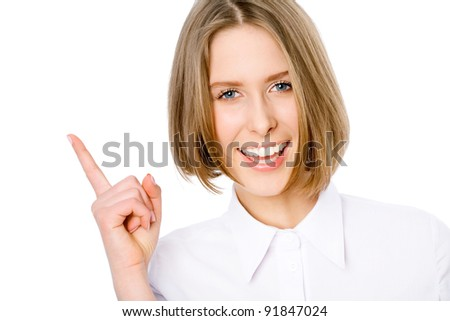 Young business woman smiling and pointing to up