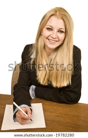 young business woman smiling writing on paper