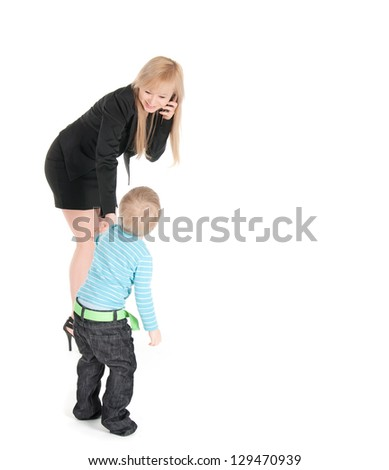 Young business woman speaking by phone and  her son over white background