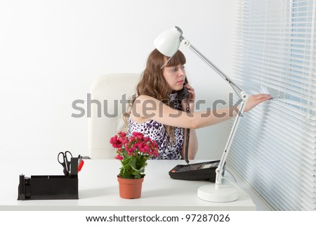 young business woman speaks by phone in a comfortable modern office - stock photo