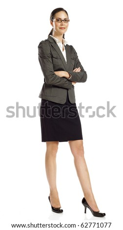 Young business woman standing and smiling - stock photo